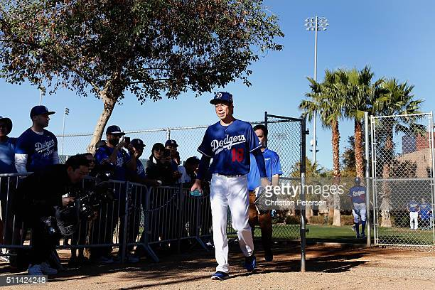 Starting pitcher Kenta Maeda of the Los Angeles Dodgers arrives to a spring training workout at Camelback Ranch on February 20 2016 in Glendale...