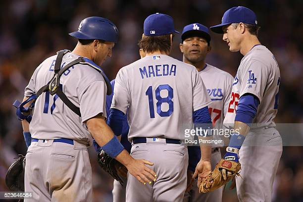 Starting pitcher Kenta Maeda of the Los Angeles Dodgers is sent off the mound by manager manager Dave Roberts and teammates A.J. Ellis, Chase Utley...