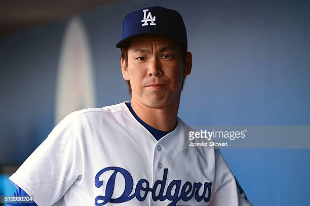 Starting pitcher Kenta Maeda of the Los Angeles Dodgers prepares to take the field during the spring training game against the Arizona Diamondbacks...