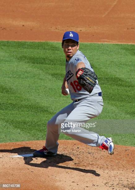 Starting pitcher Kenta Maeda of the Los Angeles Dodgers throws a pitch in the first inning during a game against the Philadelphia Phillies at...
