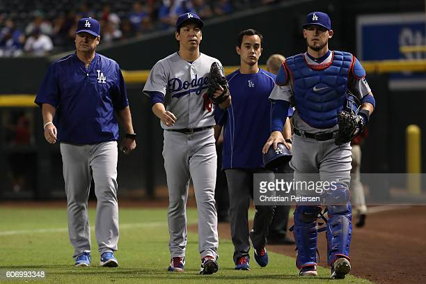 Starting pitcher Kenta Maeda of the Los Angeles Dodgers walks from the bullpen to the dugout before the start of the MLB game against the Arizona...
