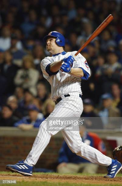 Starting pitcher Kerry Wood of the Chicago Cubs hits a two-run home run to left field against the Florida Marlins in the second inning of game seven...