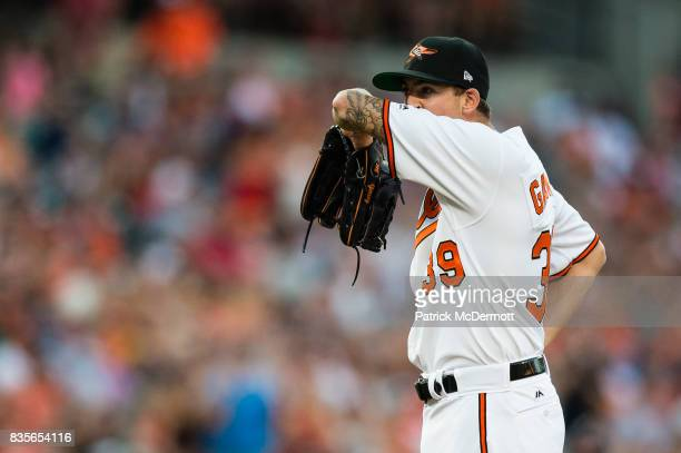 Starting pitcher Kevin Gausman of the Baltimore Orioles reacts after giving up a solo home run to Mike Trout of the Los Angeles Angels of Anaheim in...