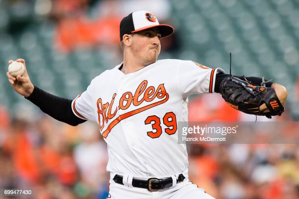 Starting pitcher Kevin Gausman of the Baltimore Orioles throws a pitch to a Cleveland Indians batter in the first inning during a game at Oriole Park...