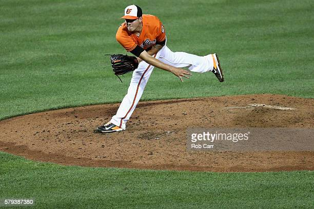 Starting pitcher Kevin Gausman of the Baltimore Orioles throws to a Cleveland Indians batter in the seventh inning at Oriole Park at Camden Yards on...