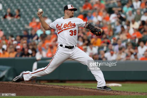 Starting pitcher Kevin Gausman of the Baltimore Orioles throws to a Texas Rangers batter in the third inning at Oriole Park at Camden Yards on July...