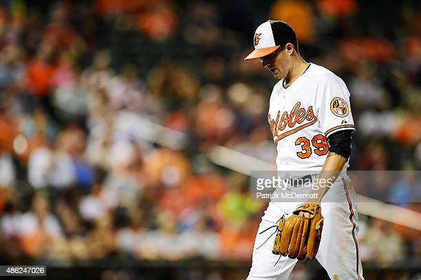 Starting pitcher Kevin Gausman of the Baltimore Orioles walks back to the dugout after being relieved in the third inning during a baseball game...