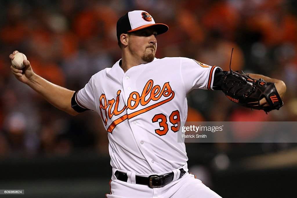 Starting pitcher Kevin Gausman #39 of the Baltimore Orioles works the first inning against the Boston Red Sox at Oriole Park at Camden Yards on September 20, 2016 in Baltimore, Maryland.