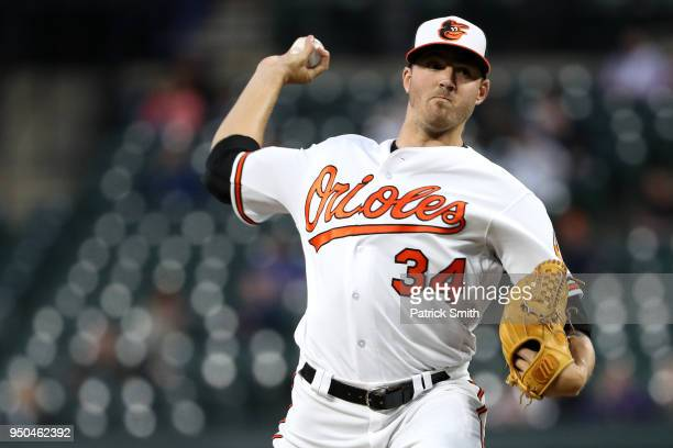 Starting pitcher Kevin Gausman of the Baltimore Orioles works the third inning against the Cleveland Indians at Oriole Park at Camden Yards on April...