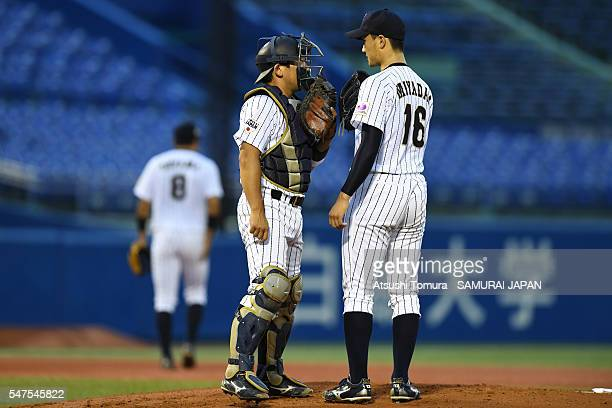 Starting pitcher Kohei Miyadai of Japan and Taiki Morikawa of Japan talk on the mounds in the top of first inning on the day 3 match between Japan...