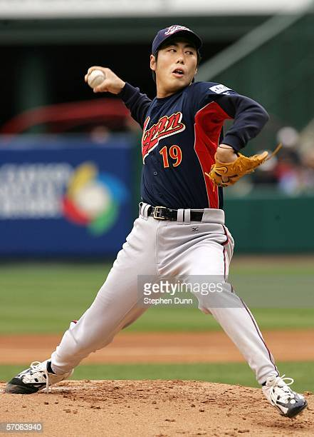 Starting pitcher Koji Uehara of Team Japan pitches against Team USA during the Round 2 Pool 2 Game of the World Baseball Classic on March 12 2006 at...