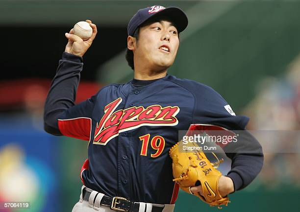 Starting pitcher Koji Uehara of Team Japan pitches against Team USA during the Round 2 Pool 2 Game of the World Baseball Classic at Angel Stadium on...