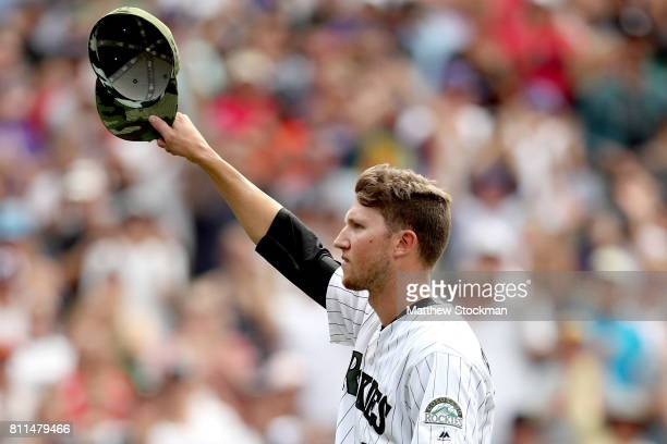 Starting pitcher Kyle Freeland of the Colorado Rockies acknowledges the crowd as he leaves the game in the ninth inning against the Chicago White Sox...