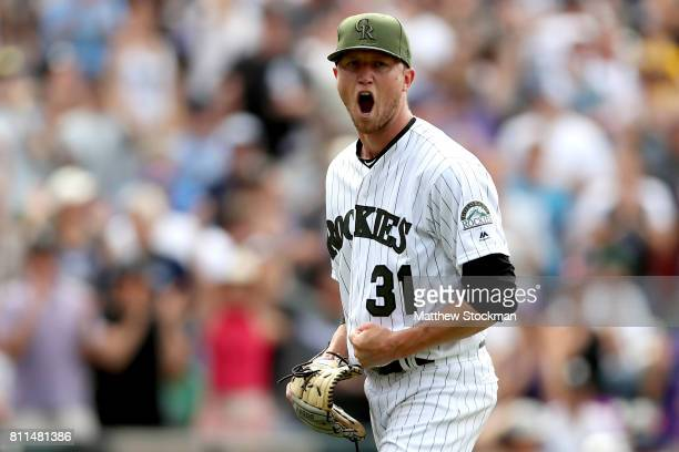 Starting pitcher Kyle Freeland of the Colorado Rockies celebrates the third out of the eighth inning against the Chicago White Sox at Coors Field on...
