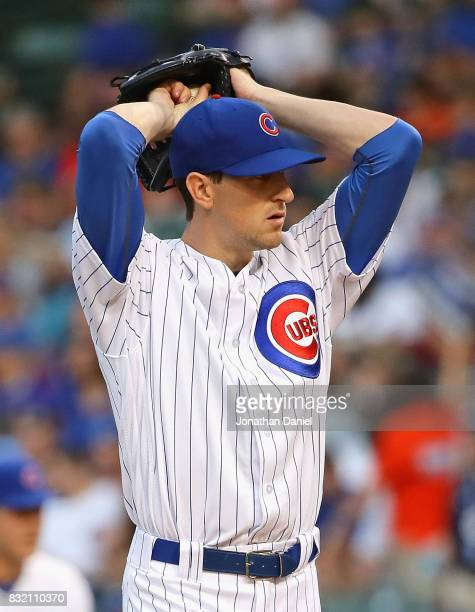 Starting pitcher Kyle Hendricks of the Chicago Cubs delivers the ball against the Cincinnati Reds at Wrigley Field on August 15 2017 in Chicago...