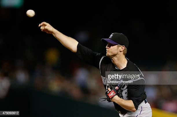 Starting pitcher Kyle Kendrick of the Colorado Rockies pitches against the Arizona Diamondbacks during the first inning of the MLB game at Chase...