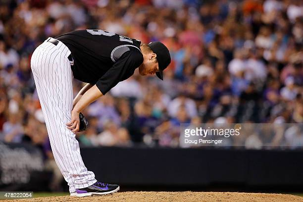 Starting pitcher Kyle Kendrick of the Colorado Rockies reacts after giving up a solo home run to A.J. Pollock of the Arizona Diamondbacks to give the...