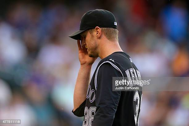 Starting pitcher Kyle Kendrick of the Colorado Rockies reacts while walking off the field during the second inning against the Houston Astros during...