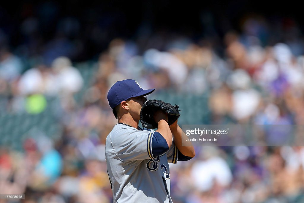 Starting pitcher Kyle Lohse #26 of the Milwaukee Brewers reacts after giving up a two-run home run to Charlie Blackmon #19 of the Colorado Rockies during the fifth inning at Coors Field on June 20, 2015 in Denver, Colorado.