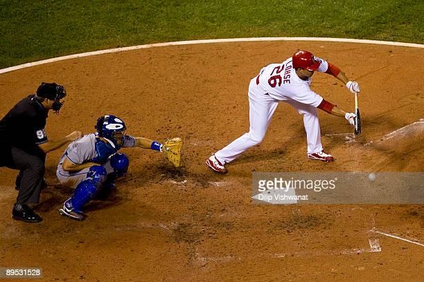 Starting pitcher Kyle Lohse of the St. Louis Cardinals bunts against the Los Angeles Dodgers July 30, 2009 at Busch Stadium in St. Louis, Missouri....