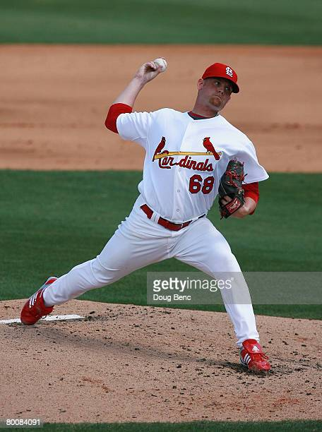 Starting pitcher Kyle McClellan of the St Louis Cardinals pitches against the Florida Marlins during a Spring Training game at Roger Dean Stadium on...
