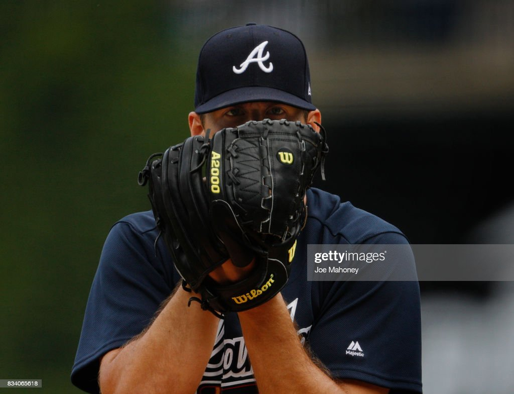 Starting pitcher Lucas Sims #50 of the Atlanta Braves stares at home plate in the first inning at Coors Field on August 17, 2017 in Denver, Colorado.