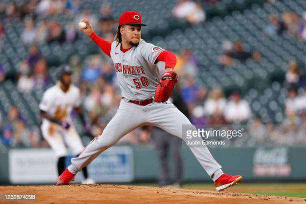 Starting pitcher Luis Castillo of the Cincinnati Reds delivers to home plate during the first inning against the Colorado Rockies at Coors Field on...