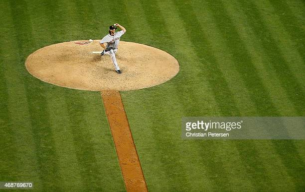 Starting pitcher Madison Bumgarner of the San Francisco Giants pitches against the Arizona Diamondbacks during the Opening Day MLB game at Chase...