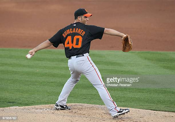 Starting pitcher Madison Bumgarner of the San Francisco Giants pitches against the Texas Rangers during the MLB spring training game at Surprise...