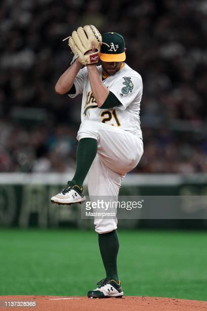 Starting pitcher Marco Estrada of the Oakland Athletics throws in the 1st inning during the game between Seattle Mariners and Oakland Athletics at...