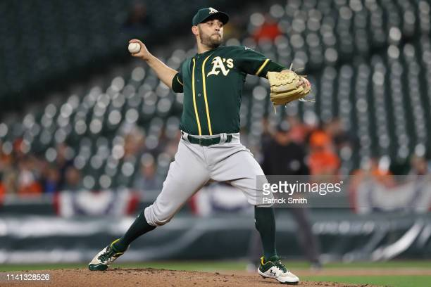 Starting pitcher Marco Estrada of the Oakland Athletics works the first inning against the Baltimore Orioles at Oriole Park at Camden Yards on April...