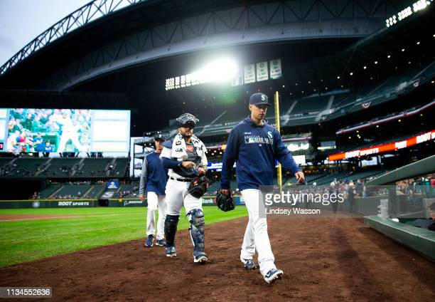 Starting pitcher Marco Gonzales of the Seattle Mariners arrives with catcher Omar Narvaez before the game against the Los Angeles Angels of Anaheim...