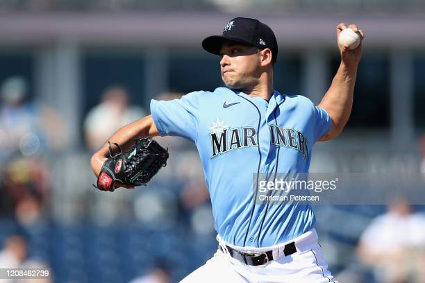 Starting pitcher Marco Gonzales of the Seattle Mariners pitches against the Chicago Cubs during the frist inning of the MLB spring training game at...
