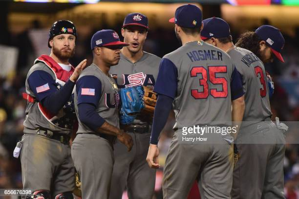 Starting pitcher Marcus Stroman of team United States is met by teammates on the mound after he gave up his no-hitter in the seventh inning against...