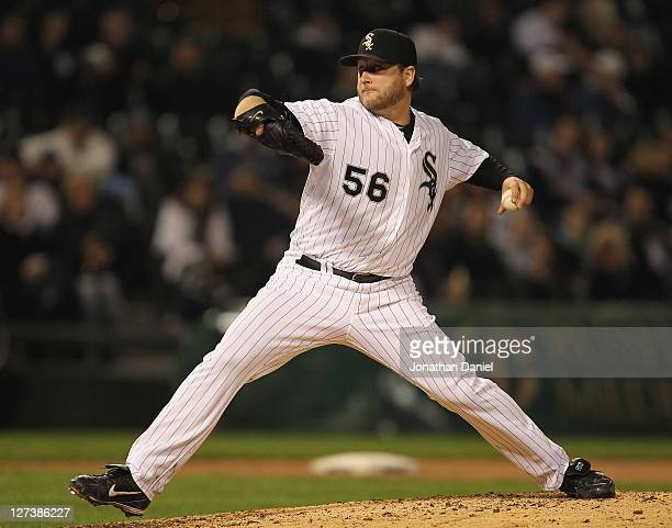 Starting pitcher Mark Buehrle of the Chicago White Sox delivers the ball against the Toronto Blue Jays at US Cellular Field on September 27 2011 in...
