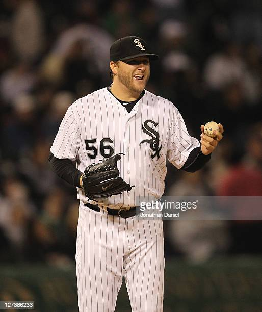 Starting pitcher Mark Buehrle of the Chicago White Sox shares a laugh with first baseman Adam Dunn during a game against the Toronto Blue Jays at US...