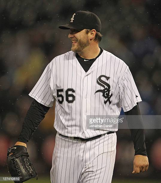 Starting pitcher Mark Buehrle of the Chicago White Sox smiles at a teammate during a game against the Toronto Blue Jays at US Cellular Field on...