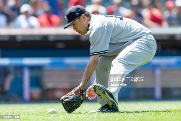 Starting pitcher Masahiro Tanaka of the New York Yankees fields a sacrifice bunt hit by Greg Allen of the Cleveland Indians during the fifth inning...