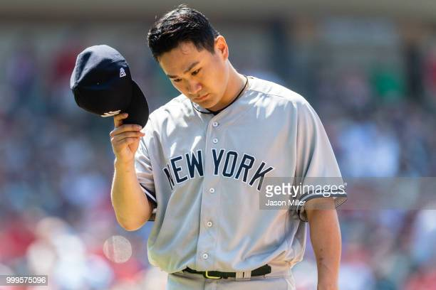 Starting pitcher Masahiro Tanaka of the New York Yankees leaves the game during the seventh inning against the Cleveland Indians at Progressive Field...