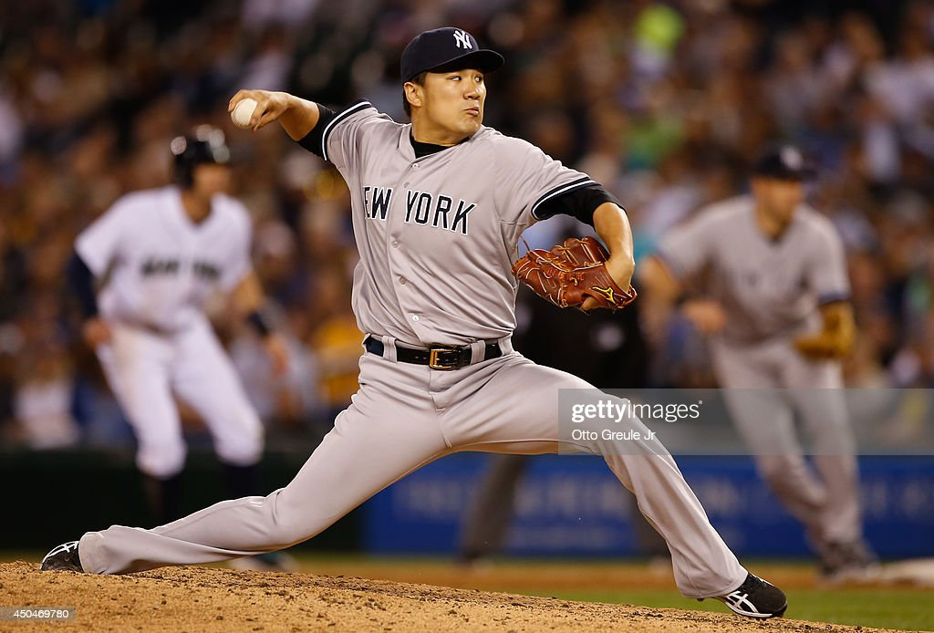Starting pitcher Masahiro Tanaka #19 of the New York Yankees pitches in the eighth inning against the Seattle Mariners at Safeco Field on June 11, 2014 in Seattle, Washington.