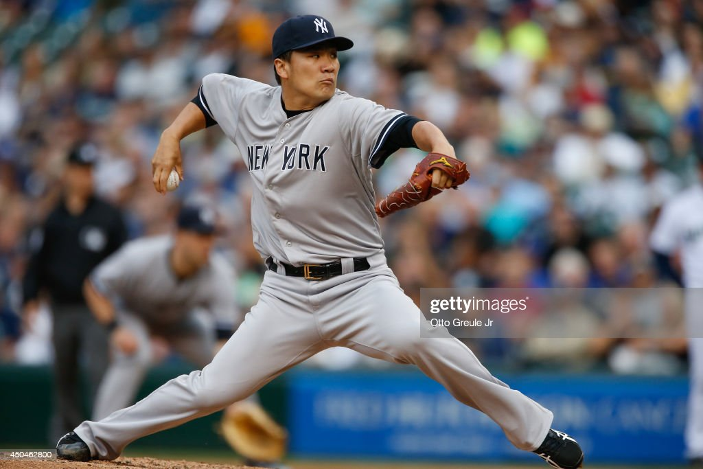 Starting pitcher Masahiro Tanaka #19 of the New York Yankees pitches against the Seattle Mariners in the first inning at Safeco Field on June 11, 2014 in Seattle, Washington.