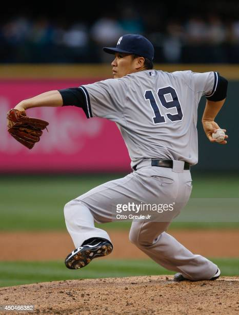 Starting pitcher Masahiro Tanaka of the New York Yankees pitches against the Seattle Mariners in the third inning at Safeco Field on June 11 2014 in...