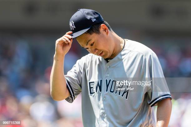 Starting pitcher Masahiro Tanaka of the New York Yankees reacts after the top third inning against the Cleveland Indians at Progressive Field on July...