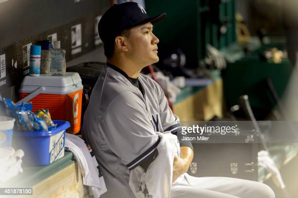 Starting pitcher Masahiro Tanaka of the New York Yankees sits in the dugout after leaving the game during the seventh inning against the Cleveland...