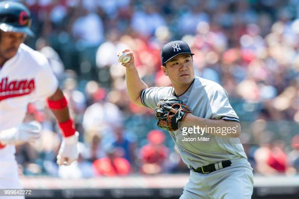 Starting pitcher Masahiro Tanaka of the New York Yankees throws out Greg Allen of the Cleveland Indians on a sacrifice bunt during the fifth inning...