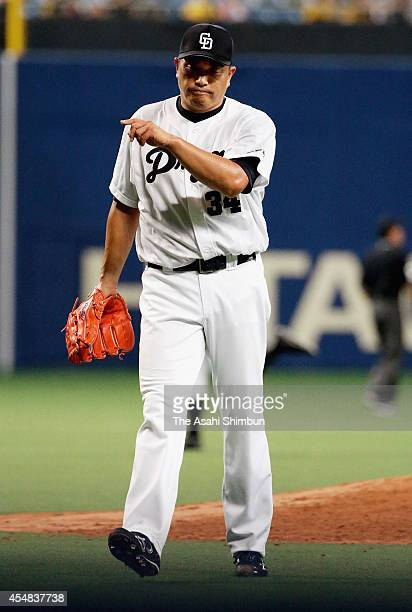 Starting pitcher Masahiro Yamamoto walks to the dugout after the top of third inning during the Central League game against Hanshin Tigers at Nagoya...