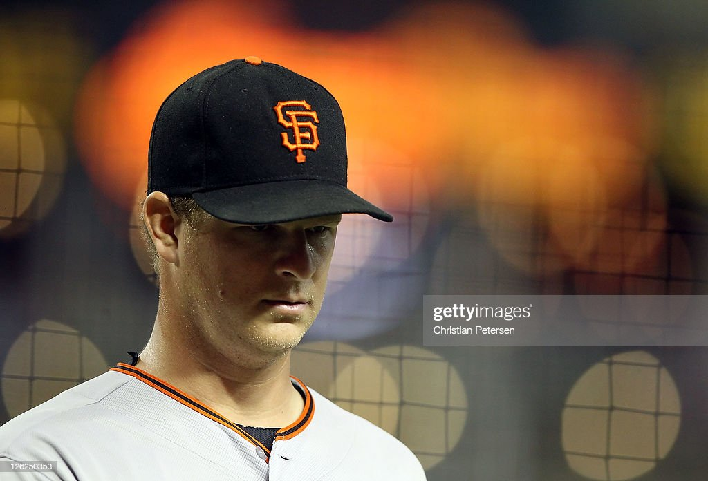 Starting pitcher Matt Cain #18 of the San Francisco Giants walks back to the dugout during the Major League Baseball game against the Arizona Diamondbacks at Chase Field on September 23, 2011 in Phoenix, Arizona.