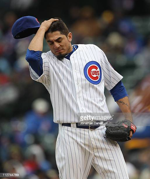 Starting pitcher Matt Garza of the Chicago Cubs reacts after walking the bases loaded in the 6th inning against the San Diego Padres at Wrigley Field...