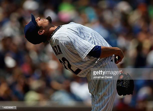 Starting pitcher Matt Garza of the Chicago Cubs stretches before throwing against the Arizona Diamondbacks at Wrigley Field on July 15 2012 in...