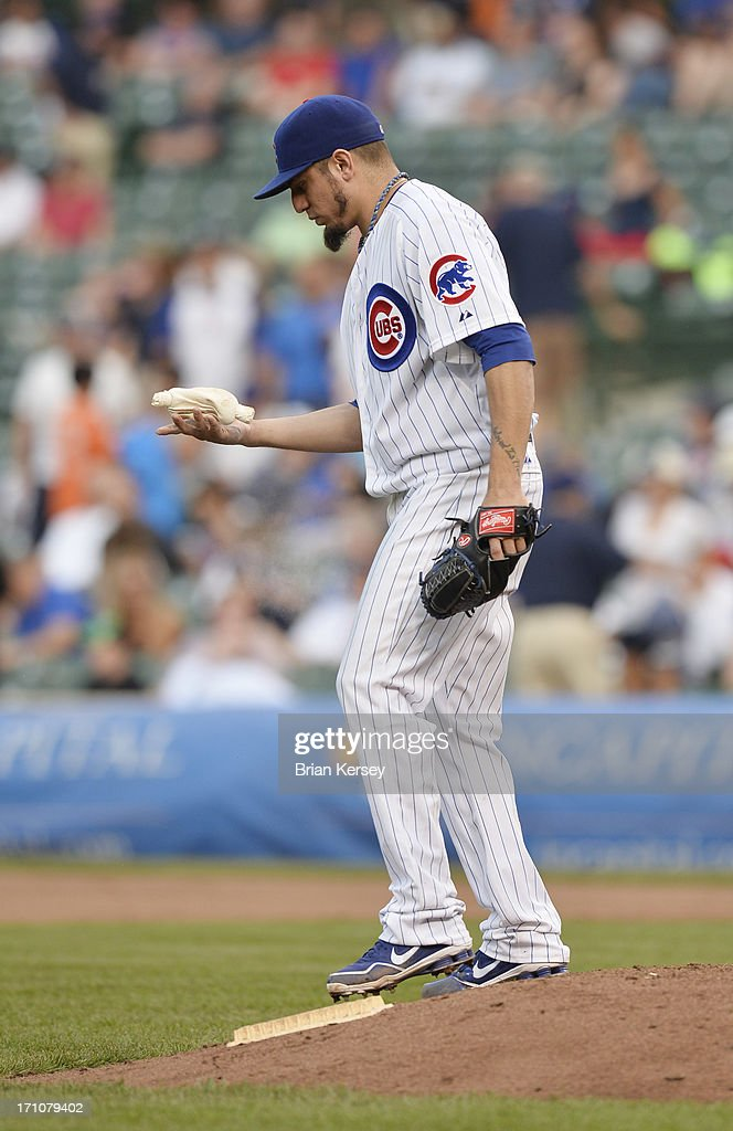 Starting pitcher Matt Garza #22 of the Chicago Cubs tosses the rosin bag during the ninth inning against the Houston Astros at Wrigley Field on June 21, 2013 in Chicago, Illinois. The Cubs defeated the Astros 3-1.
